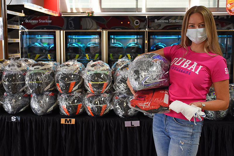 Disinfected helmets and race suits are wrapped in plastic exclusively for each guest. Photo: Aaron Meriwether